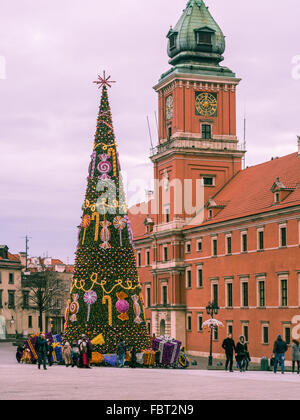 Castle Square in the Old Town of Warsaw, Poland in the early evening at Christmas time. - Stock Photo