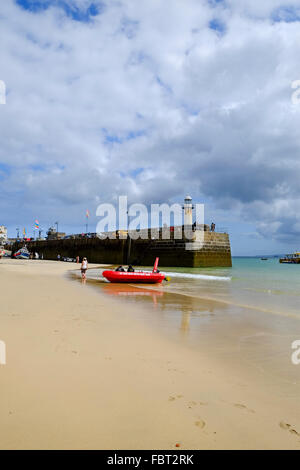 St Ives, Cornwall, UK: The harbor beach at low tide - Stock Photo