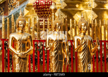 Gold Buddha statues in Wat Phra That Doi Suthep - Stock Photo