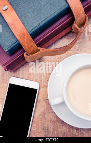 Smartphone with coffee and diaries - Stock Photo