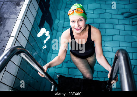 Woman Climbing Out Of A Pool Stock Photo Royalty Free Image 19119610 Alamy