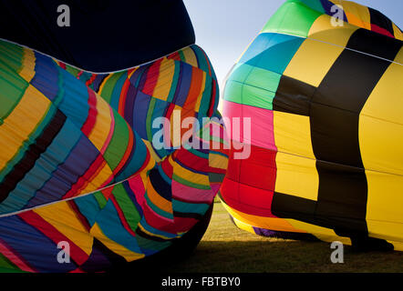 The canopies of two hot air balloons being inflated in close proximity - Stock Photo