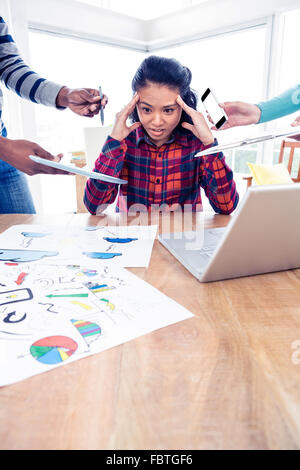 Stressful young businesswoman looking down - Stock Photo