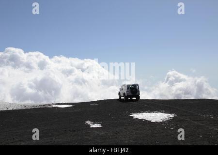 off-road Vehicle on Mt Etna volcano - Stock Photo