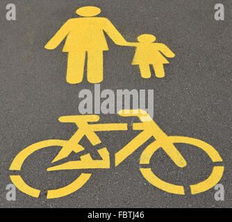 Pedestrian and bicycle road signs on the street - Stock Photo