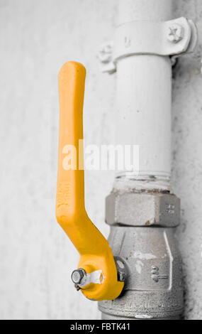Home gas yellow throttle on a outdoor wall - Stock Photo