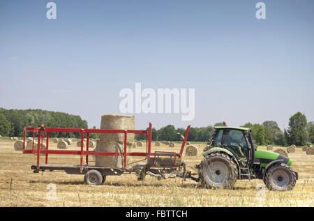 Tractor on hay balls - Stock Photo
