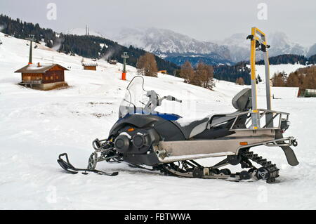 Snowmobile on alps in winter time - Stock Photo