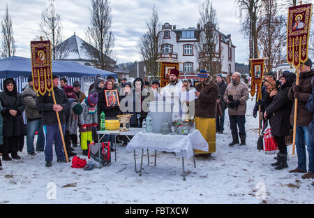 Schwerin, Germany. 19th Jan, 2016. Russian Orthodox Priest Dionisi Idavain (c) blesses members of his community, - Stock Photo