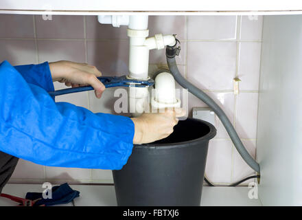 plumber drain pipes - Stock Photo