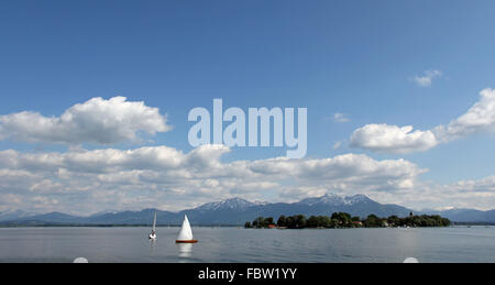 Sailing infront of Frauenchiemsee - Stock Photo