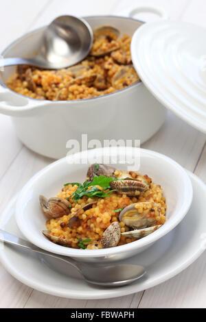sardinian pasta with clams, italian cuisine, fregula con vongole, fregola con arselle - Stock Photo