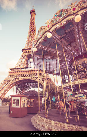 view of the eiffel tower and landmark carousel seen from Paris France - Stock Photo