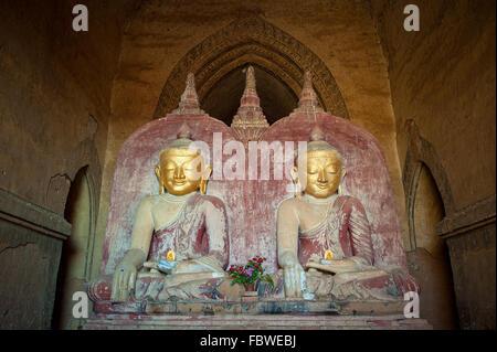 Buddha statues in the Dhammayangyi Temple, Bagan, Myanmar - Stock Photo