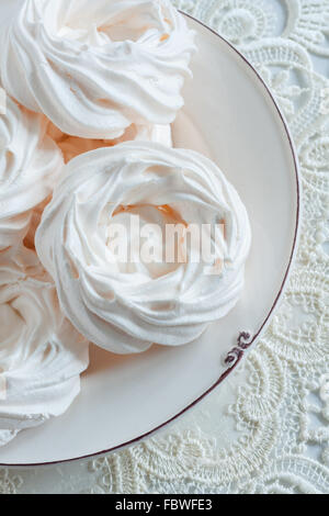 Meringue Nests a light airy confection made from whipped egg whites and sugar - Stock Photo