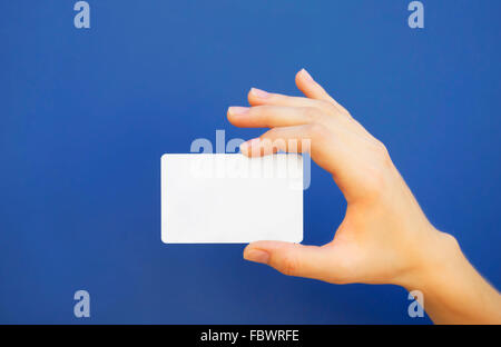 Hand holding a blank card - Stock Photo