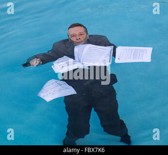 Senior man holding mortgage loan document in water - Stock Photo