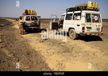 Two Toyota off-road vehicles in the Danakil depression, Afar Region, Ethiopia - Stock Photo