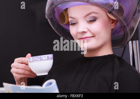 Woman in curlers with tea stock photo royalty free image for Reading beauty salon