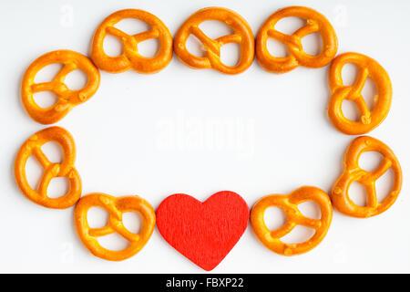 Frame Of Pretzels And Red Heart Valentine Love Symbol On White Stock