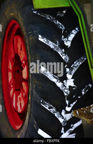 Tire of a tractor with snow profile - Stock Photo