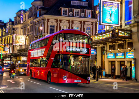 View of Bright Red London bus at twilight, Picadilly Circus, London - Stock Photo
