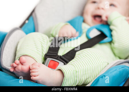 Little baby child in safety car seat - Stock Photo