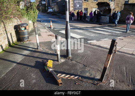 A view of Mill Hey in Haworth, England, after floods caused part of a pub wall to collapse. - Stock Photo