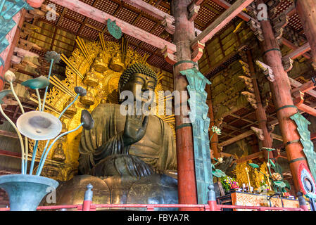 NARA, JAPAN - NOVEMBER 19, 2015: The Todaiji Buddha. It is considered the world's largest bronze statue of the Buddha - Stock Photo
