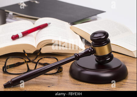 Wooden gavel on a table - Stock Photo