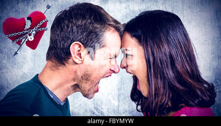 Composite image of couple yelling while standing head to head - Stock Photo