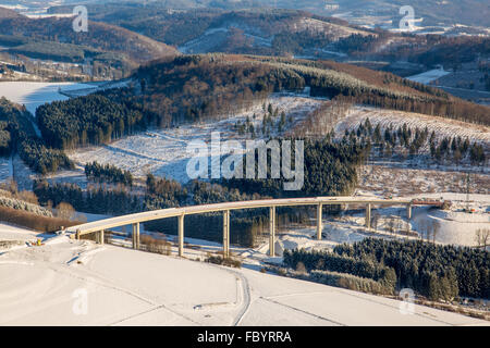 Aerial view, expansion of the A46 motorway bridge Nuttlar in the snow, the highest bridge in the state of North - Stock Photo