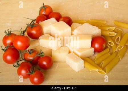 Italian grana padano, pasta and tomatoes - Stock Photo