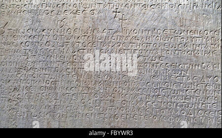 Ancient greek text carved on marble - Stock Photo