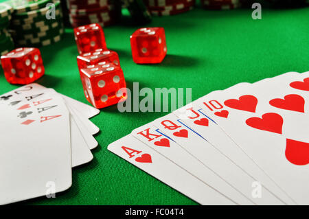 Composition with playing cards on green table - Stock Photo