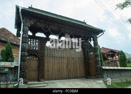 Typical wooden door carved in the district of Maramures, Romania - Stock Photo