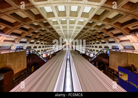WASHINGTON, D.C. - APRIL 10, 2015: Trains and passengers in a Metro Station. Opened in 1976, the Washington Metro - Stock Photo