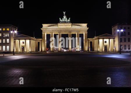 brandenburg gate in berlin at night - Stock Photo