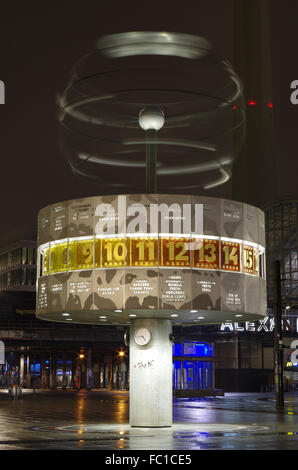 world time clock in berlin at night - Stock Photo