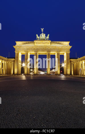 brandenburg gate in berlin at blue our - Stock Photo