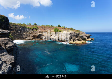 dream coastline at Bali, near Manta Point famous Diving place, Nusa Penida with blue sky - Stock Photo