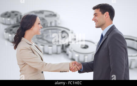 Composite image of future partners shaking hands - Stock Photo