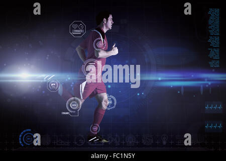 Composite image of football player in red running - Stock Photo