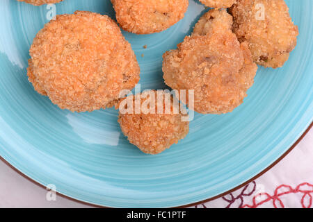 meat chop on blue plate with red pepper - Stock Photo