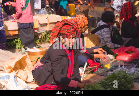 A lady selling her goods in Nampan Market on Inle Lake, Myanmar - Stock Photo