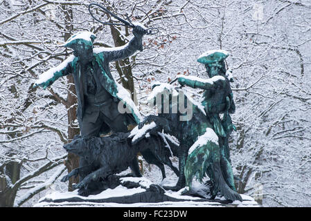 Snow covered parkland in Tiergarten Park in central Berlin in winter 2016, with monuments and trees and lake Berlin - Stock Photo