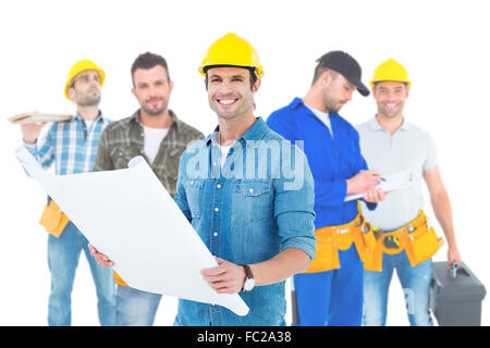 Composite image of happy architect holding blueprint in house - Stock Photo