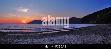 Sunset at the beach of Porto - Corsica - Stock Photo