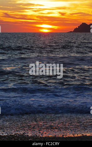 Sunset on the beach of Porto - Corsica - Stock Photo