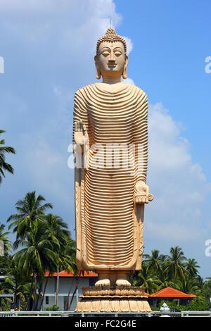 Peraliya Buddha Statue in Hikkaduwa - Stock Photo